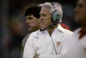 SAN FRANCISCO CA CIRCA 1980's Head Coach of the San Francisco 49ers Bill Walsh with the head set on watching the action from the sidelines during a...