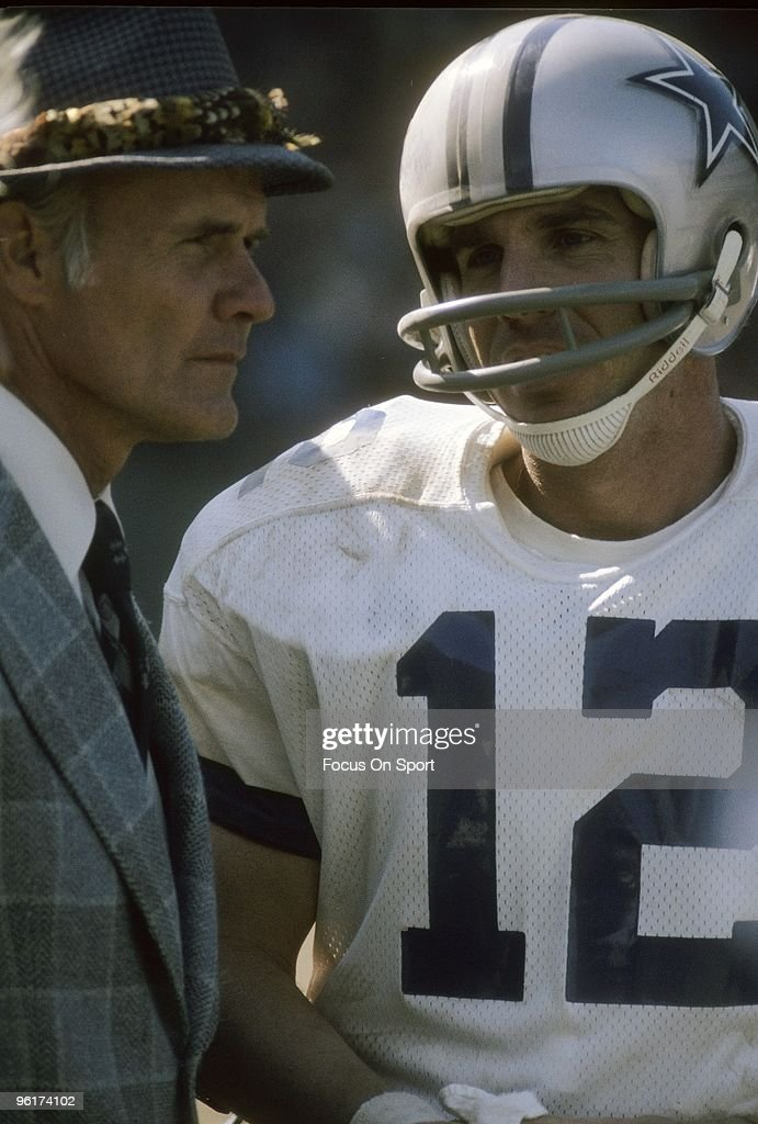 CIRCA 1970's: Head coach <a gi-track='captionPersonalityLinkClicked' href=/galleries/search?phrase=Tom+Landry&family=editorial&specificpeople=240241 ng-click='$event.stopPropagation()'>Tom Landry</a> (L) of the Dallas Cowboys talks with his quarterback <a gi-track='captionPersonalityLinkClicked' href=/galleries/search?phrase=Roger+Staubach&family=editorial&specificpeople=208812 ng-click='$event.stopPropagation()'>Roger Staubach</a> #12 during a circa 1970s NFL football game. Landry coached the Cowboys from 1960-88.