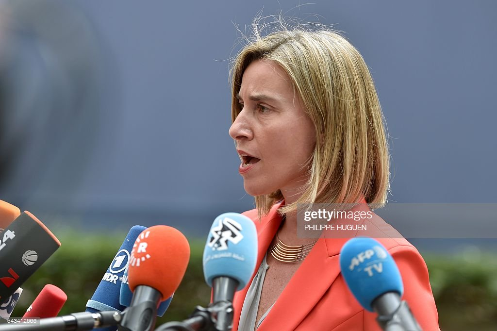 EU's High representative for foreign affairs and security policy Federica Mogherini talks to journalists as she arrives before an EU summit meeting on June 28, 2016 at the European Union headquarters in Brussels. / AFP / PHILIPPE