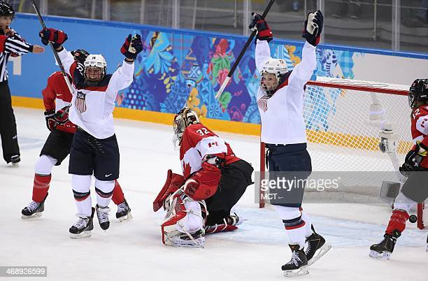 USA's Hilary Knight celebrates her goal with Kelli Stack against Canada goalkeeper Charline Labonte in the second period of a women's hockey game at...