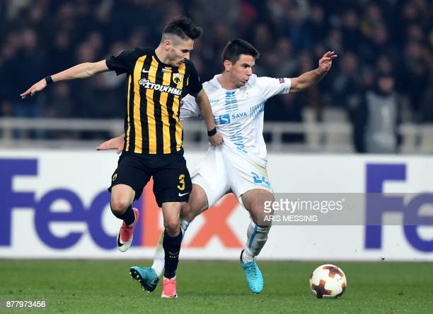 AEK's Hélder Lopes fights for the ball with Rijeka's Domagoj Pavicic during the UEFA Europa League Group D football match between AEK Athens and...