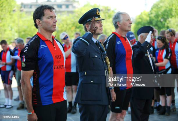 VIP's hold a silence with the Help for Heroes Band of Brothers bike riders attend a wreath laying ceremony at the Arc de Triomphe Paris before...