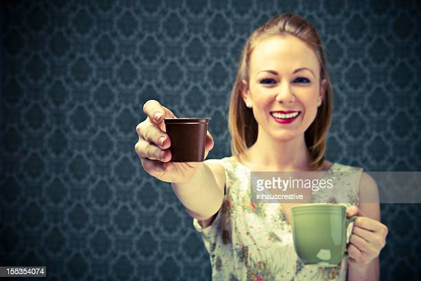 50's Housewife enjoying her coffee capsule