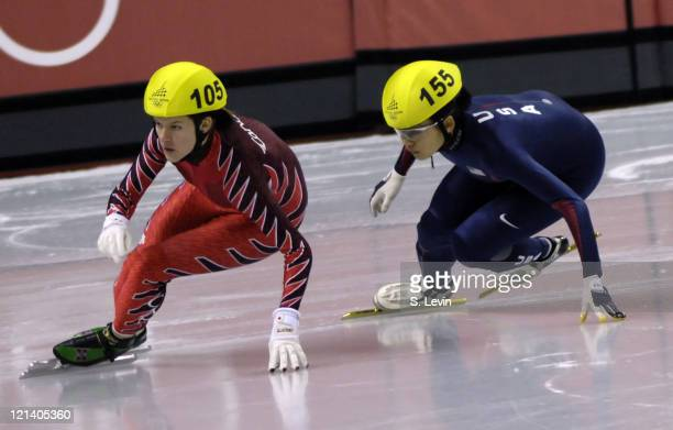 USA's HyoJung Kim tries to catch Canada's Anouk LeblancBoucher in the Womens 500 M Short Track event at the Palavela venue in Torino Italy on...