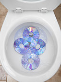 CD's in a toilet bowl