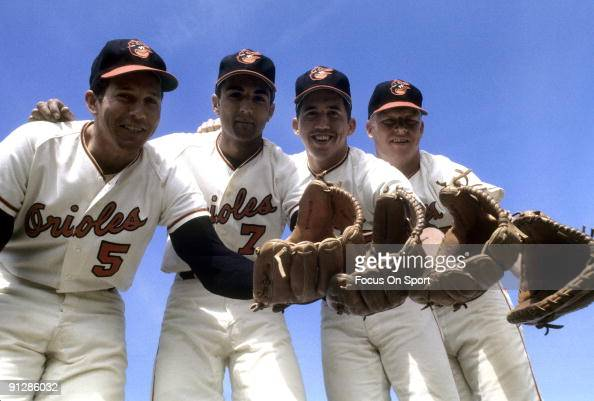 CIRCA 1960's Infielder Brooks Robinson Mark Belanger Davey Johnson second from right and Boog Powell far righr of the Baltimore Orioles poses for...