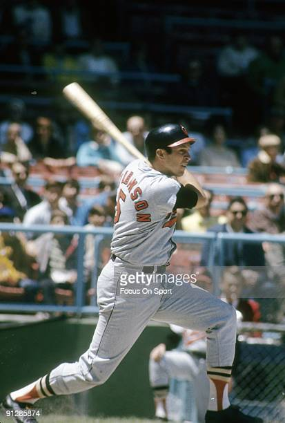 CIRCA 1960's Infielder Brooks Robinson of the Baltimore Orioles in action swings and watches the flight of his ball during a Major League Baseball...