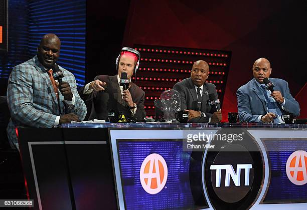 TNT's Inside the NBA team NBA analyst Shaquille O'Neal host Ernie Johnson Jr wearing an iGrow laserbased hairgrowth helmet and NBA analysts Kenny...