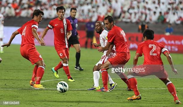 UAE's Ismaeil Matar fights for the ball against Hong kong's Huayang Yang Bai He Leung Chun Pong and Lee Chi Ho during their AFC Asian Cup 2015...