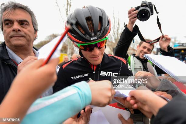 BMC's Italian rider Alessandro De Marchi signs autographs before the start of the fifth stage of the 97th Volta Catalunya 2017 a 182km from Valls to...