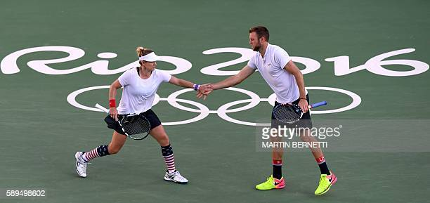 USA's Jack Sock and USA's Bethanie MattekSands react as they play against USA's Venus Williams and USA's Rajeev Ram during their mixed doubles gold...