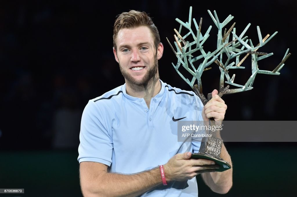 USA's Jack Sock holds the trophy 'Fanti's Tree' after winning against Serbia's Filip Krajinovic during the final of the ATP World Tour Masters 1000 indoor tennis tournament on November 5, 2017 in Paris. Sock won the match 5-7, 6-4 and 6-1. /