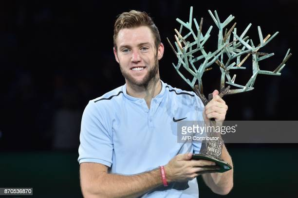 USA's Jack Sock holds the trophy 'Fanti's Tree' after winning against Serbia's Filip Krajinovic during the final of the ATP World Tour Masters 1000...
