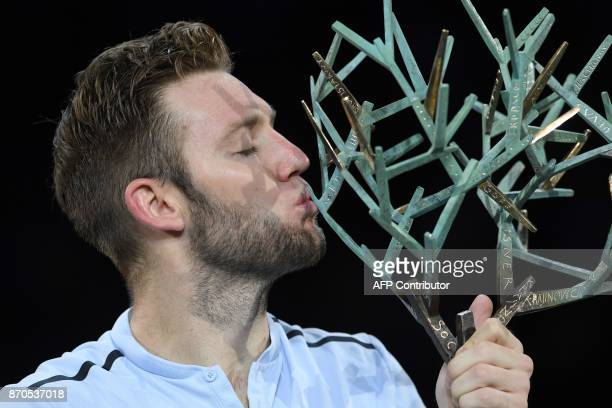 TOPSHOT USA's Jack Sock kisses the trophy after winning against Serbia's Filip Krajinovic during the final of the ATP World Tour Masters 1000 indoor...