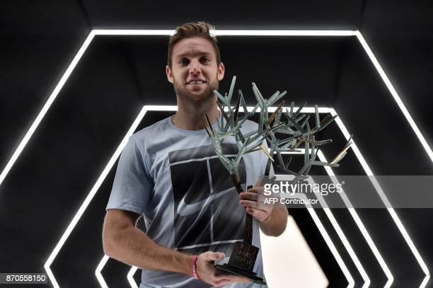 USA's Jack Sock poses with the trophy after winning against Serbia's Filip Krajinovic during the final of the ATP World Tour Masters 1000 indoor...