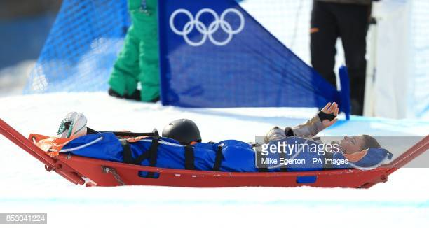 USA's Jacqueline Hernandez is stretchered off the course during Women's Snowboard Cross at Rosa Khutor Extreme Park during the 2014 Sochi Olympic...