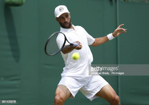 USA's James Blake in action against Australia's Bernard Tomic during day four of the Wimbledon Championships at The All England Lawn Tennis and...