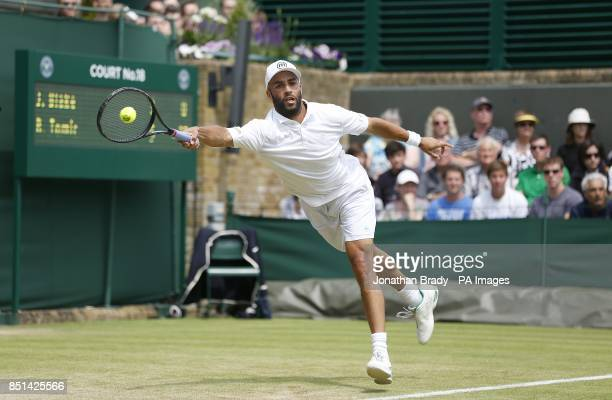 USA's James Blake in action during his match against Australia's Bernard Tomic during day four of the Wimbledon Championships at The All England Lawn...