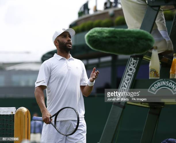 USA's James Blake questions the decision of the umpire during his match against Australia's Bernard Tomic during day four of the Wimbledon...