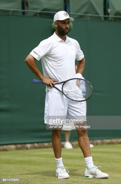 USA's James Blake stands dejected during his match against Australia's Bernard Tomic during day four of the Wimbledon Championships at The All...