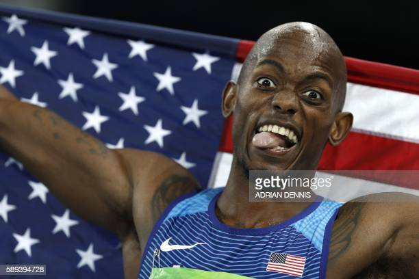 TOPSHOT USA's Jeff Henderson celebrates winning the Men's Long Jump Final during the athletics event at the Rio 2016 Olympic Games at the Olympic...
