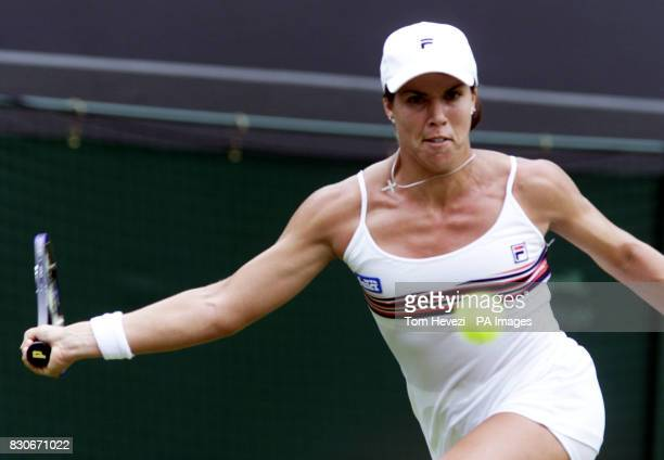 USA's Jennifer Capriati in action against Sandrine Testud of France during their Fourth Round match of the Lawn Tennis Championships at Wimbledon...