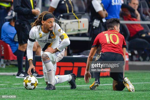 LA's Jermaine Jones and Atlanta's Miguel Almiron look to the referee after they collided during the first half of the match between Atlanta United...