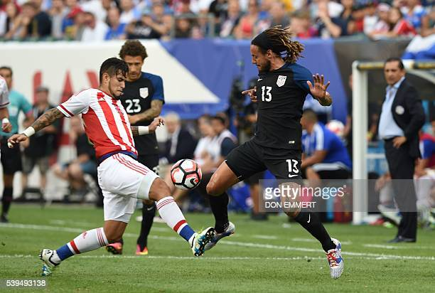 USA's Jermaine Jones and Paraguay's Victor Hugo Ayala vie for the ball during their Copa America Centenario football tournament match in Philadelphia...