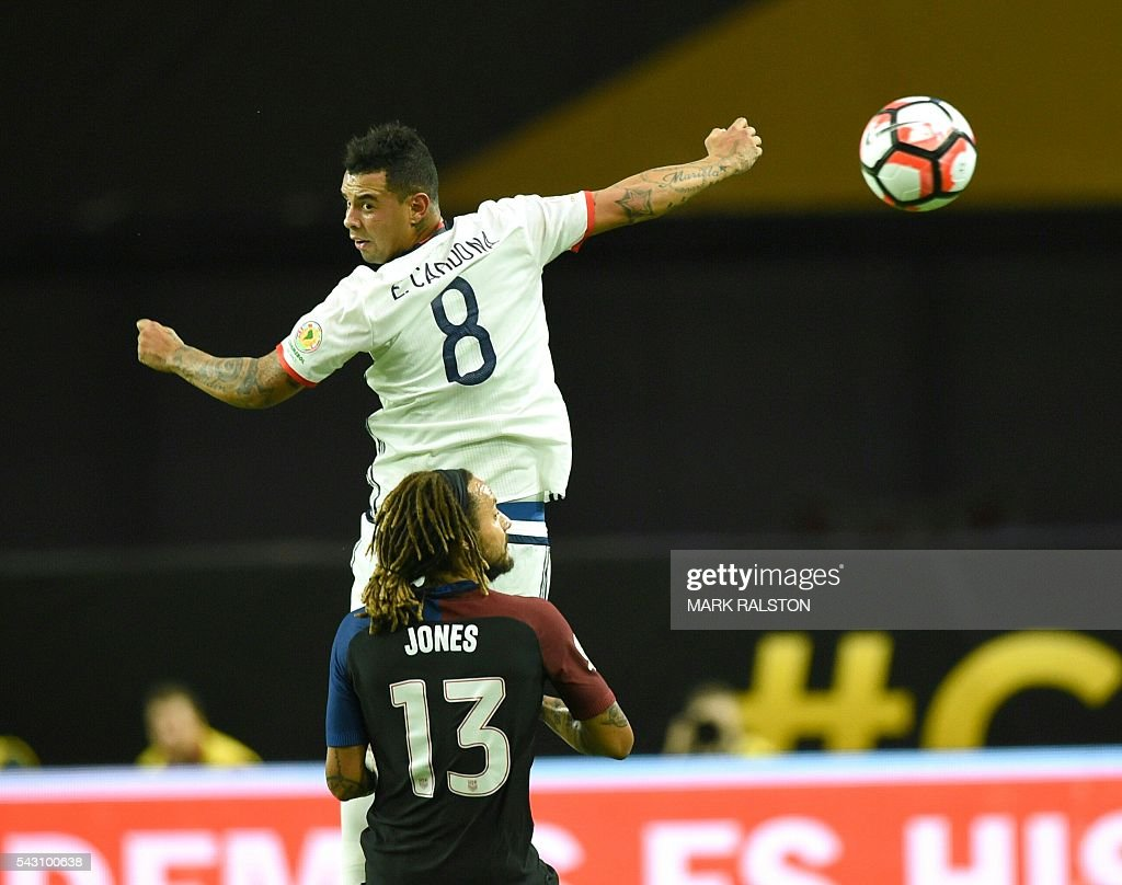 USA's Jermaine Jones (bottom) vies for the ball with Colombia's Edwin Cardona during the Copa America Centenario third place football match in Glendale, Arizona, United States, on June 25, 2016. / AFP / Mark RALSTON