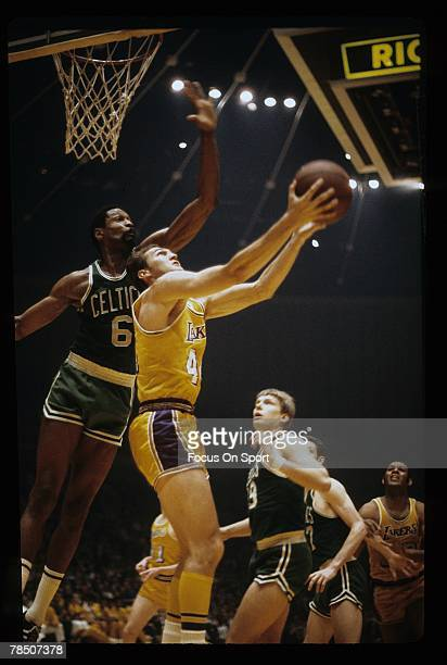 LOS ANGELES CA CIRCA 1960's Jerry West of the Los Angeles Lakers attempts a reverse layup against Bill Russell of the Boston Celtics during a late...