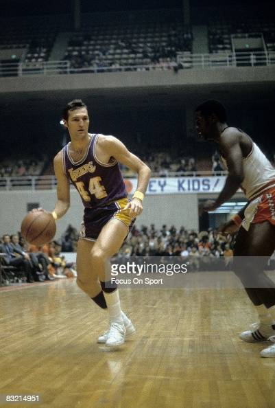 BALTIMORE MD CIRCA 1970's Jerry West of the Los Angeles Lakers dibbles towards the basket against a Baltimore Bullets defenders during a early circa...