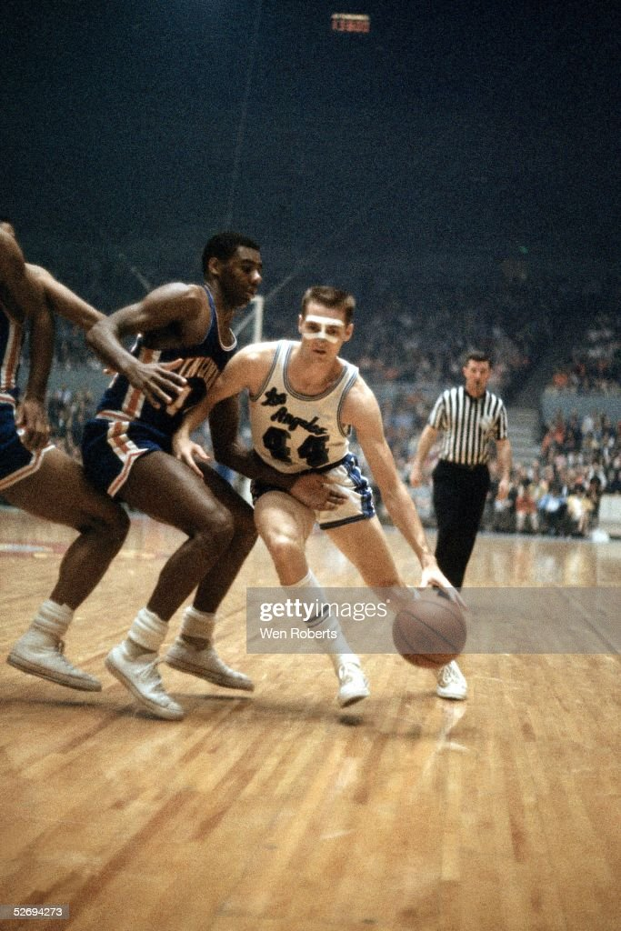 LOS ANGELES 1960's Jerry West of the Los Angeles Lakers dribble drives against the Cincinnati Royals during the NBA game at the Los Angeles Sports...