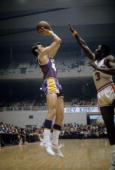 BALTIMORE MD CIRCA 1970's Jerry West of the Los Angeles Lakers shoots over Fred Carter of the Baltimore Bullets during a early circa 1970's NBA...
