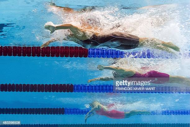 USA's Jessica Hardy and Russia's Yuliya Efiomva compete in the semifinals of the women's 50m breaststroke swimming event at the 2015 FINA World...