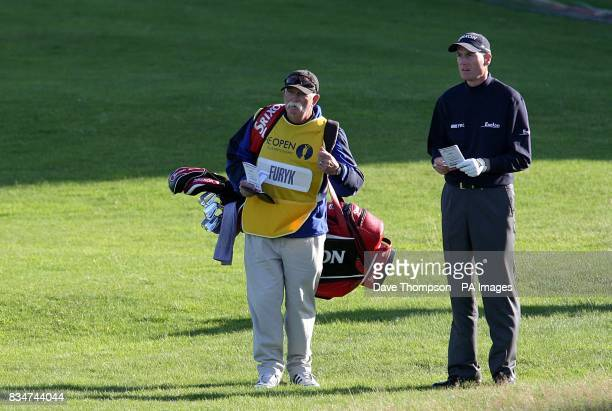 USA's Jim Furyk talks with his caddie