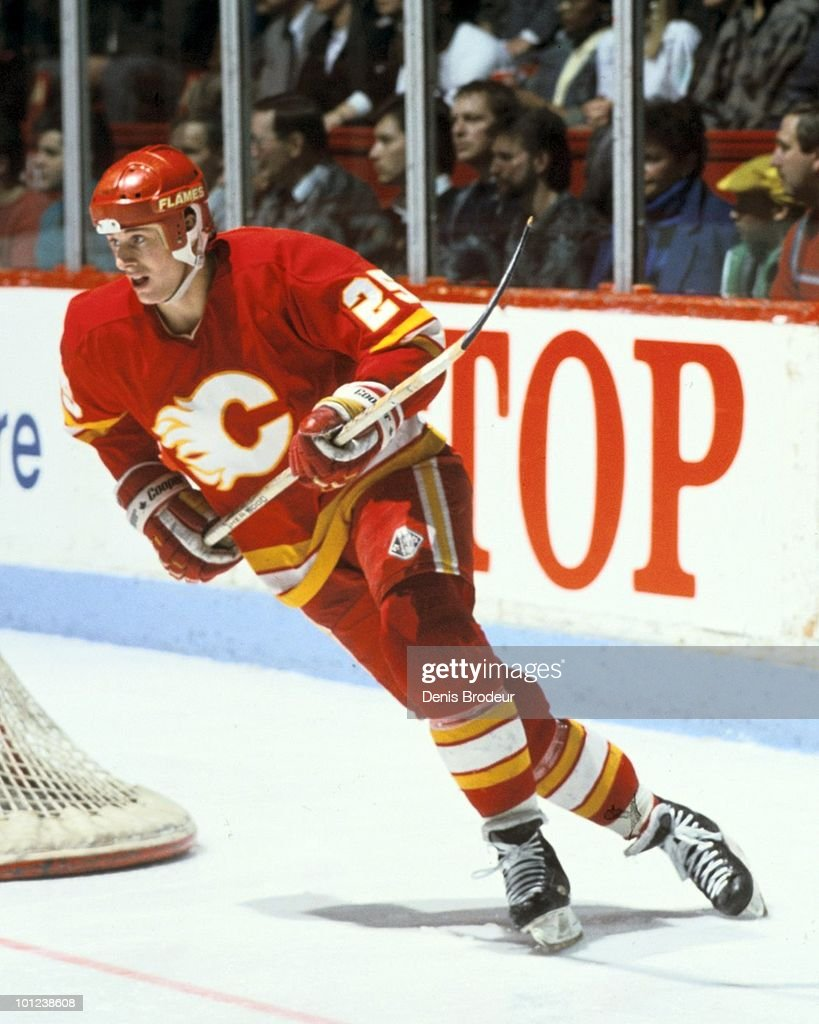 MONTREAL - 1980's: Joe Nieuwendyk #25 of the Calgary Flames skates against the Montreal Canadiens in the late 1980's at the Montreal Forum in Montreal, Quebec, Canada.