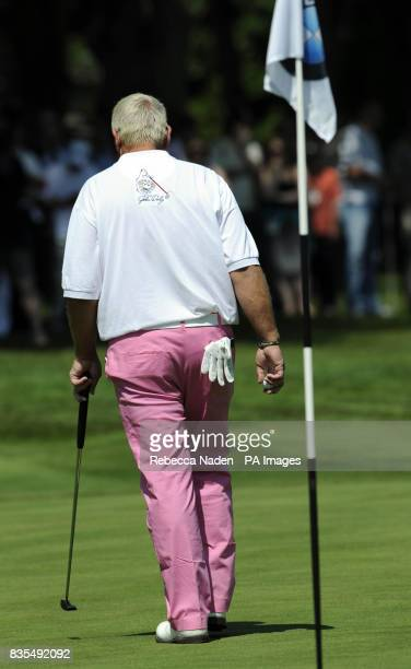 USA's John Daly putts on the 18th green during Round 4 of the BMW PGA Championship at Wentworth Golf Club Surrey