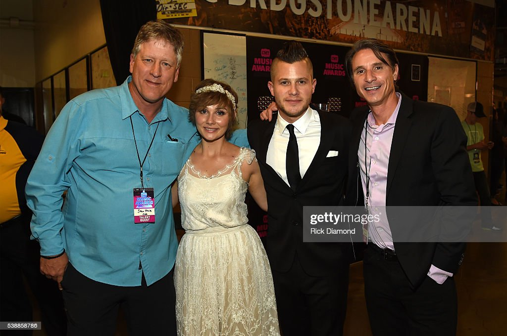 CAA's John Huie, actress Clare Bowen, fiance Brandon Robert Young, and CAA's Matt Maher attend the 2016 CMT Music awards at the Bridgestone Arena on June 8, 2016 in Nashville, Tennessee.
