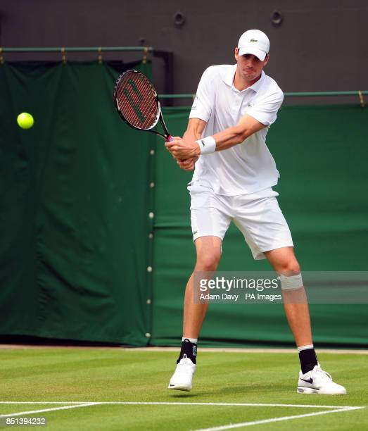 USA's John Isner in action against France's Adrian Mannarino during day Three of the Wimbledon Championships at The All England Lawn Tennis and...
