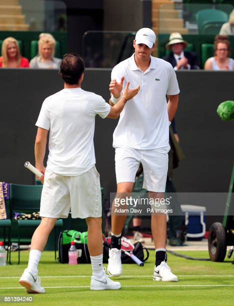 USA's John Isner shakes hands with France's Adrian Mannarino after retiring from the match during day Three of the Wimbledon Championships at The All...
