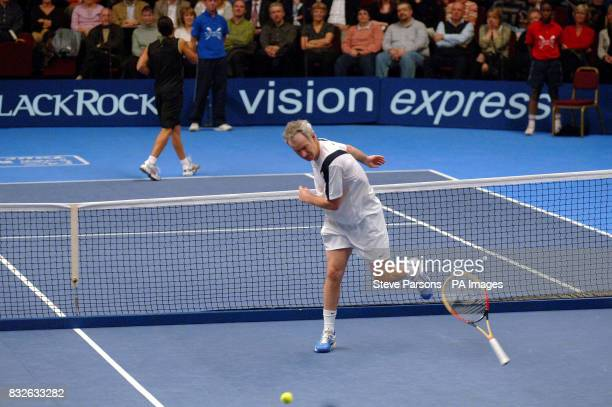 USA's John McEnroe loses his racket in frustration during the Blackrock Masters match against Marcelo Rios at the Royal Albert Hall London