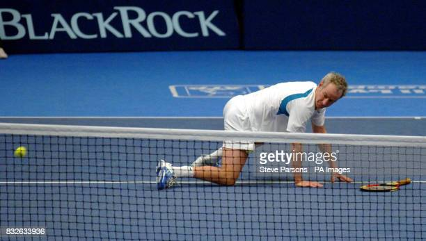 USA's John McEnroe picks himself up during the Blackrock Masters against Marcelo Rios at the Royal Albert Hall London