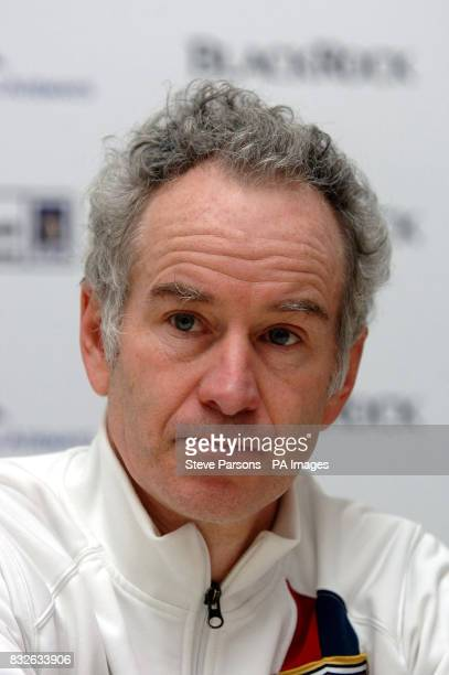USA's John McEnroe talks during a press conference after losing to Marcelo Rios during the Blackrock Masters at the Royal Albert Hall London