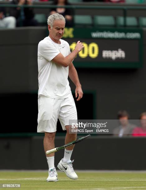 USA's John McEnroe throws down his racquet whilst playing with partner Patrick McEnroe against Australia's Paul McNamee and Peter McNamara in their...