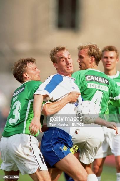 B93's Jonny Laursen battles with AB's Jan Bjur and Rene Henriksen for the ball