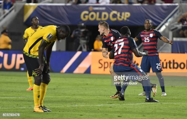 USA's Jordan Morris celebrates with teammate Jozy Altidore and Darlington Nagbe after scoring a goal against Jamaica during the final football game...