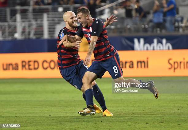 USA's Jordan Morris celebrates with teammate Michael Bradley after scoring a goal against Jamaica during the final football game of the 2017 CONCACAF...