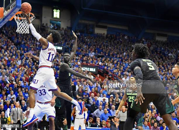 KU's Josh Jackson beats Baylor's Jo LualAcuil for a bucket during the first half on Wednesday Feb 1 at Allen Fieldhouse in Lawrence Kan Kansas won...