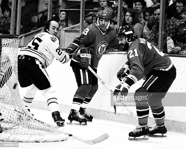 BOSTON MA 1970's JP Parise and Dennis Maruk of the Cleveland Barons in game action against Gary Doak of the Boston Bruins at Boston Garden