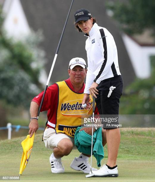 USA's Juli Inkster lines up a putt on the 4th green with her caddy during the third round of the Weetabix Women's British Open at Royal Lytham and St...